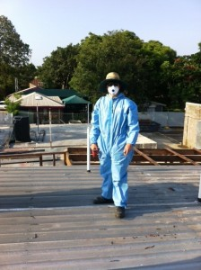 Electrician kitted out to work on asbestos roof